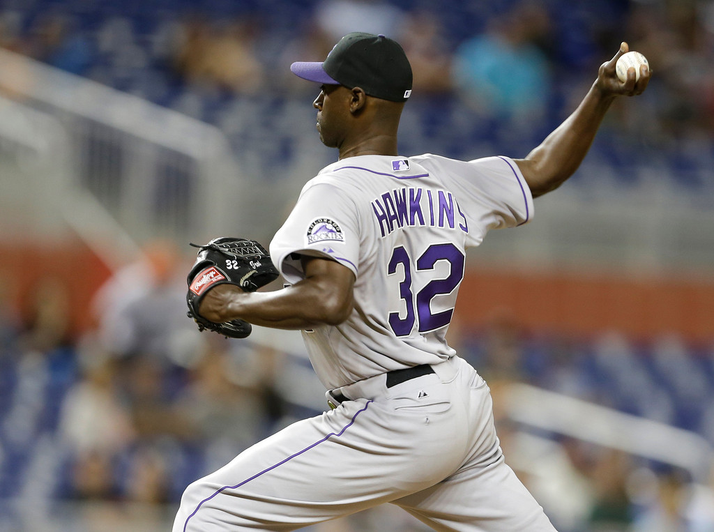 . Colorado Rockies relief pitcher LaTroy Hawkins throws in the ninth inning of a baseball game against the Miami Marlins, Wednesday, April 2, 2014, in Miami. The Rockies defeated the Marlins 6-5. (AP Photo/Lynne Sladky)