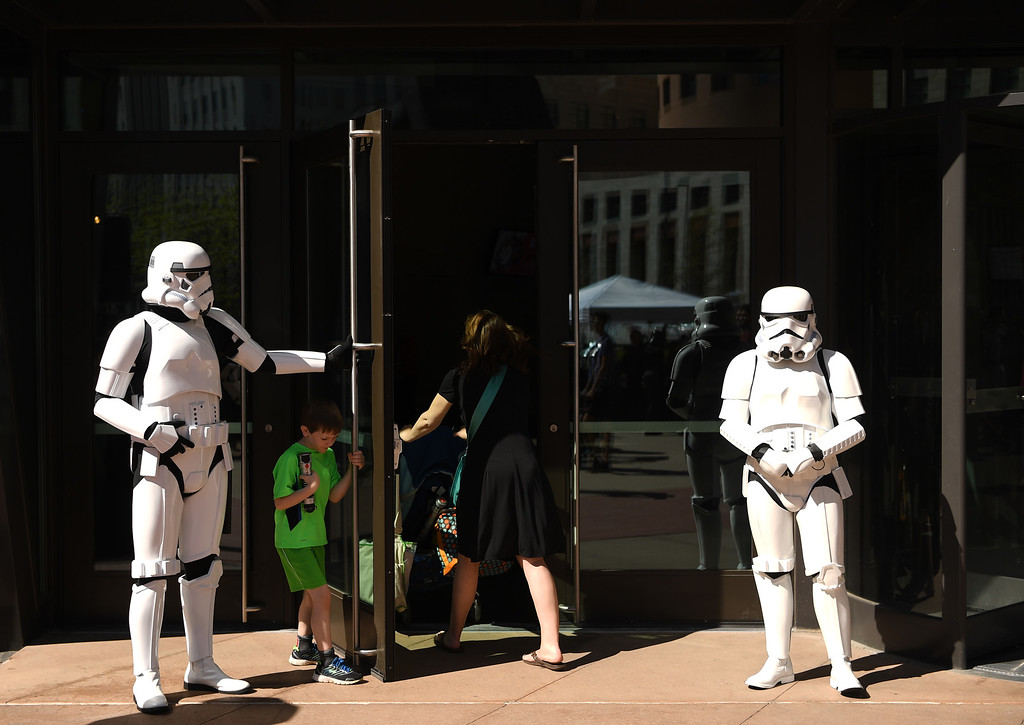 . A Stormtrooper holds the doors for visitors at the Denver Art Museum during a May the 4th Be With You event to kick off ticket sales for the upcoming exhibition, Star Wars and the Power of Costume, opening at the DAM in November, May 04, 2016. Costumed characters entertained fans at the museum. (Photo by RJ Sangosti/The Denver Post)