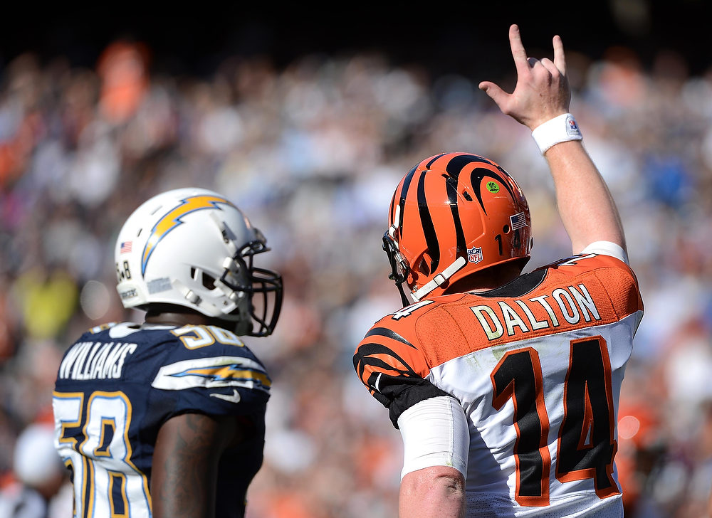 Description of . Andy Dalton #14 of the Cincinnati Bengals gestures during the game against the San Diego Chargers on December 2, 2012 at Qualcomm Stadium in San Diego, California. (Photo by Donald Miralle/Getty Images)