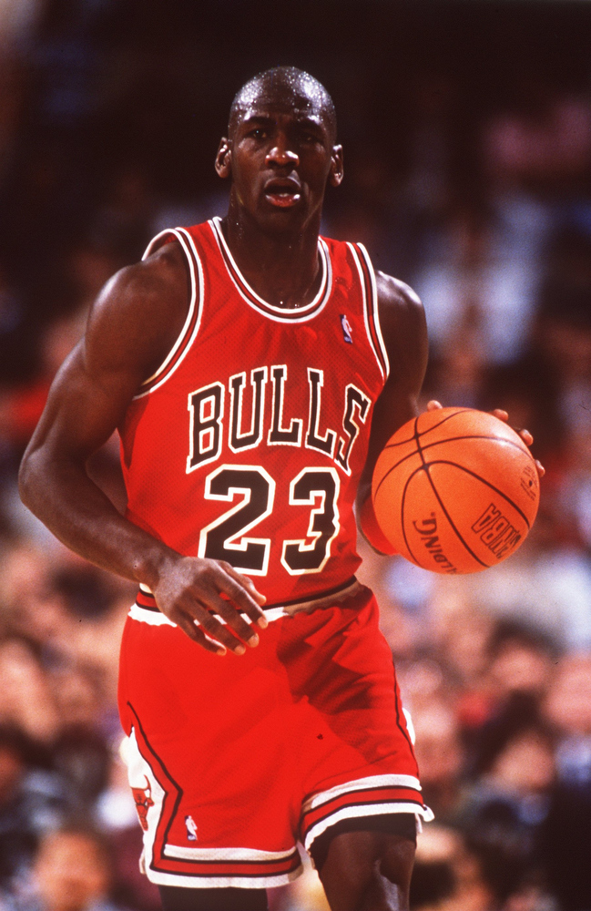 Description of . MICHAEL JORDAN OF THE CHICAGO BULLS DRIBBLES DOWNCOURT DURING AN NBA GAME. Stephen Dunn Getty Images
