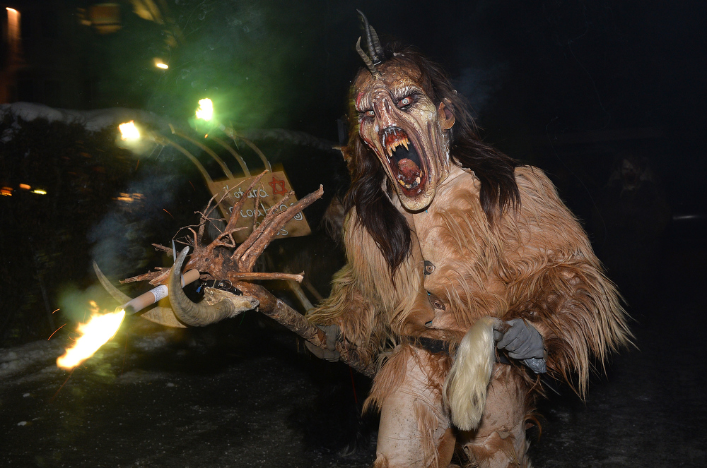 . A man dressed as a Krampus, the companion of St. Nicholas and one of Austria\'s unique Advent traditions, makes his way during a traditional Krampus procession in Lofer, Austrian province of Salzburg, Saturday, Nov. 30, 2013. (AP Photo/Kerstin Joensson)