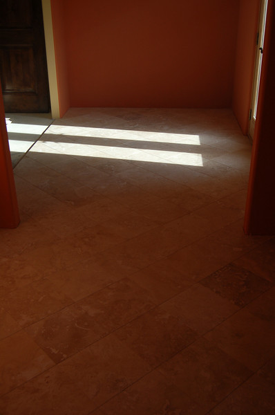 The travertine floor in the master bath.