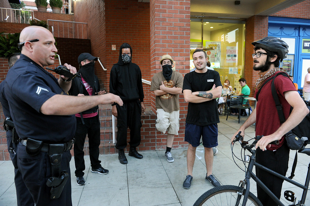 """. LAPD stops a protester during a \""""Smash White Supremacy Fun Run\"""" in Westwood, Thursday, July 18, 2013. (Michael Owen Baker/L.A. Daily News)"""