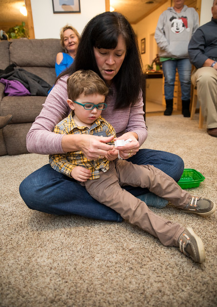 Caleb and Mimi Figuring out White Elephant Numbers.jpg