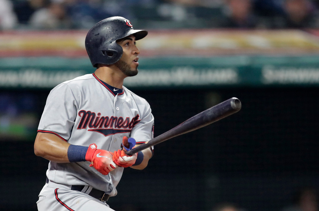 . Minnesota Twins\' Eddie Rosario watches his double off Cleveland Indians starting pitcher Carlos Carrasco during the fourth inning of a baseball game Tuesday, Aug. 7, 2018, in Cleveland. (AP Photo/Tony Dejak)