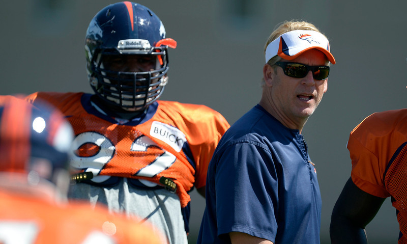 . Denver Broncos NT Sylvester Williams (92) looks on as defensive coach Jack Del Rio monitors the drills during training camp August 12, 2013 at Dove Valley. (Photo By John Leyba/The Denver Post)