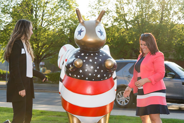 05/15/19 Wesley Bunnell | Staff The Greater New Britain Chamber of Commerce @ Tomasso Group held an after business party with food and drinks and networking before unveiling their signature bee which is part of Bees Across New Britain. Artist Deanna LaVoie, L, unveils the statue with the help of Mayor Erin Stewart.