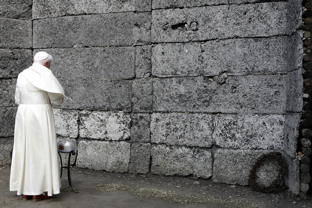 . A file picture taken on May 28, 2006 shows Pope Benedict XVI standing in front of the death wall at former Nazi concentration camp Auschwitz in Oswiecim. Pope Benedict XVI announced on February 11, 2013 he will resign on February 28 because his age prevented him from carrying out his duties, an unprecedented move in the modern history of the Catholic Church.  PIER PAOLO CITO/AFP/Getty Images