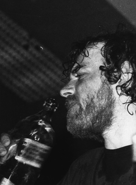 . 23rd October 1972:  English folk singer Joe Cocker takes a swig of whisky during his performance while on tour in Australia.  (Photo by Central Press/Getty Images)