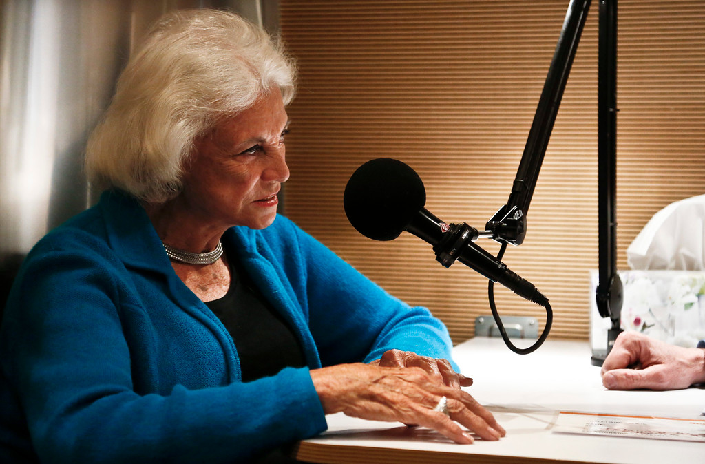 . Former United States Supreme Court justice Sandra Day O\'Connor speaks with her son Scott O\'Connor prior to being interviewed for the StoryCorps Mobile Booth at the KJZZ mobile recording studio inside an airstream trailer Thursday, Feb. 14, 2013, in Phoenix. The 40-minute recorded sessions have participants sharing their stories about family, relationships and life-altering experiences and will be aired during Morning Edition and heard nationwide by millions on National Public Radio. (AP Photo/Ross D. Franklin)