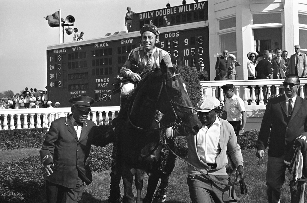 . A smiling Don Brumfield aboard Kauai King is led to the winners circle to accept the roses after winning the Kentucky Derby, May 7, 1966 in Louisville, Kentucky at Churchill Downs. Kauai King went on to win the Preakness Stakes, but finished fourth to Amberoid at Belmont. (AP Photo)