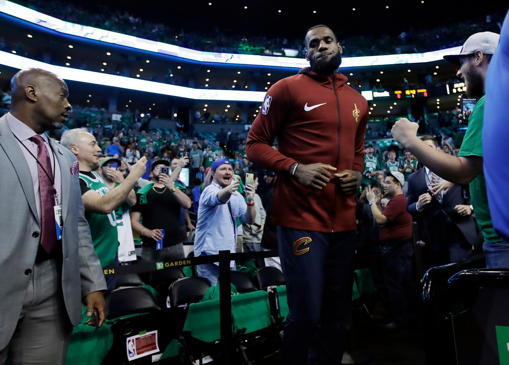 . Fans react as Cleveland Cavaliers forward LeBron James takes the court before Game 5 of the team\'s NBA basketball Eastern Conference finals against the Boston Celtics, Wednesday, May 23, 2018, in Boston. (AP Photo/Charles Krupa)