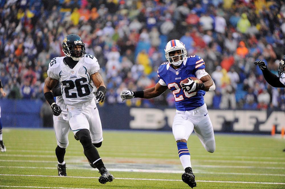 . Buffalo Bills running back C.J. Spiller (28) runs past Jacksonville Jaguars\' Dawan Landry (26) for a touchdown during the second half of an NFL football game, Sunday, Dec. 2, 2012, in Orchard Park, N.Y. (AP Photo/Gary Wiepert)