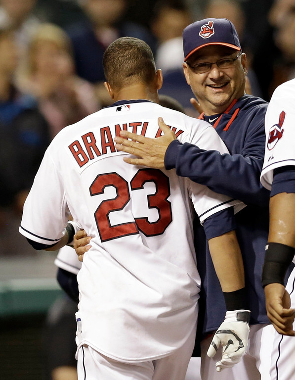 . Cleveland Indians manager Terry Francona, right, congratulates Michael Brantley after Brantley hit a game-winning solo home run off Detroit Tigers relief pitcher Al Alburquerque in the tenth inning of a baseball game, Monday, May 19, 2014, in Cleveland. (AP Photo/Tony Dejak)