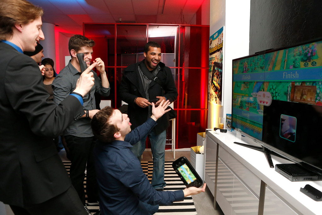 . Jared Knabenbauer, (from Pro Jared,) TJ Smith (from Ivy League Punk,) Shawn Caple (from Underbelly) and guest seen at the Nintendo Wii U Video Challenge at the Nintendo Lounge at Sundance 2013, on Thursday, January, 17, 2013 in Park City, Utah. (Photo by Todd Williamson/Invision for Nintendo/AP Images)