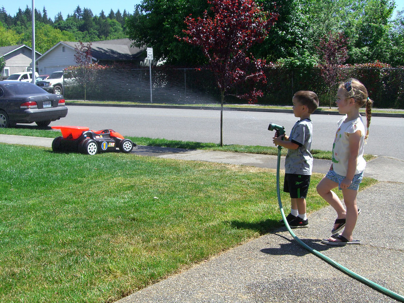 Playing with the water hose and the neighbor kids.