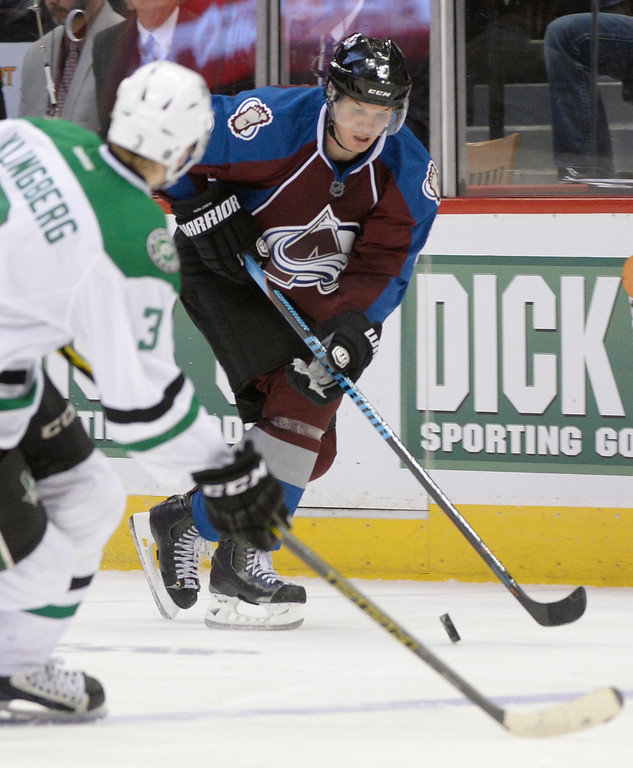 . Colorado Avalanche defenseman Nick Holden (2) prepares to make a move to get around the defense of Dallas Stars defenseman John Klingberg (3) during the third period Saturday, February 14, 2015 at the Pepsi Center in Denver, Colorado. (Photo By Brent Lewis/The Denver Post)