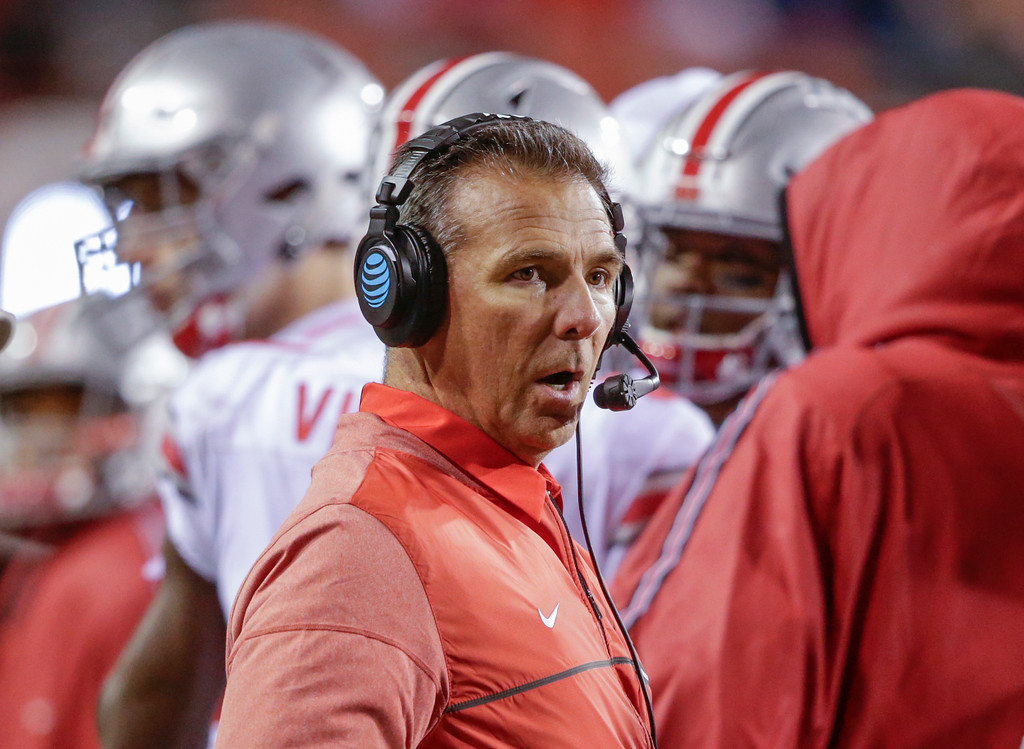 . Ohio State head coach Urban Meyer talks on his head set during the second half of an NCAA college football game against Nebraska in Lincoln, Neb., Saturday, Oct. 14, 2017. Ohio State won 56-14. (AP Photo/Nati Harnik)
