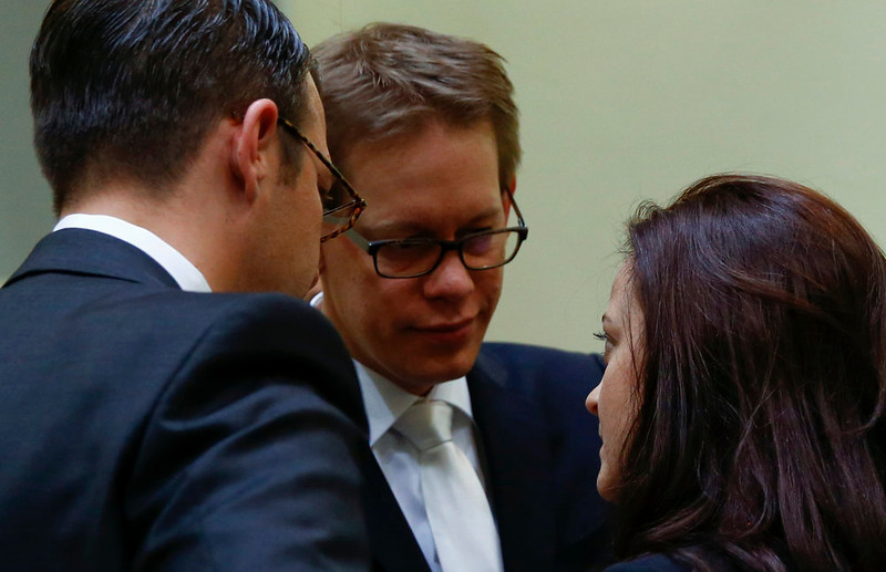 . Beate Zschaepe, a member of the neo-Nazi group National Socialist Underground (NSU), speaks to her lawyers Wolfgang Heer (C) and Wolfgang Stahl in the court before the start of the trial in Munich on May 6, 2013.    REUTERS/Michael Dalder
