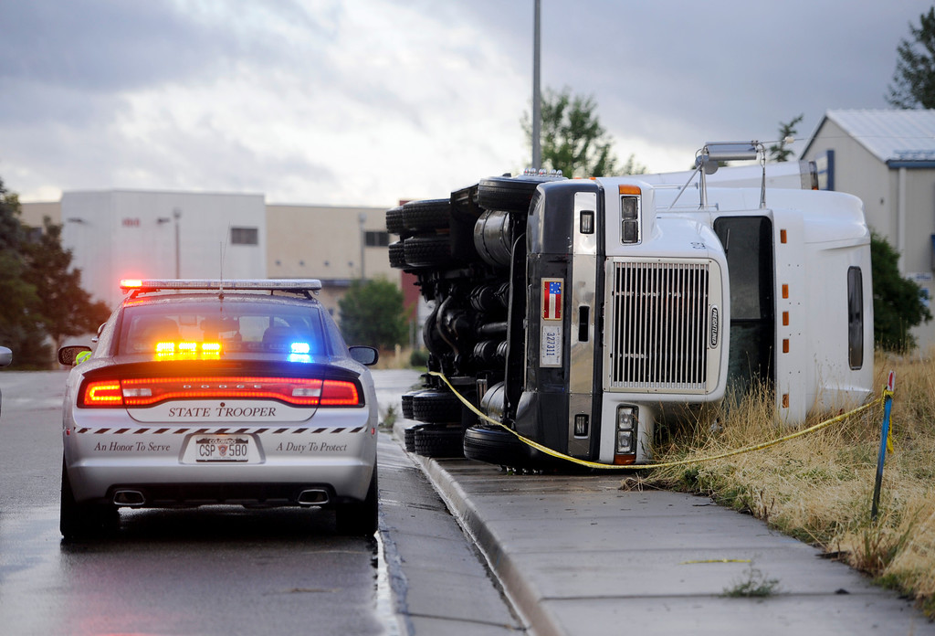. A semi-tractor truck was blow over in Erie, Colorado on August 3, 2013 due to a storm that moved through. No one was in the truck at the time. For more photos and videos of the storm damage, go to www.dailycamera.com. Cliff Grassmick  / August 3, 2013