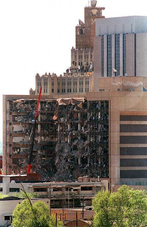 . A view dated 20 April 1995 of the west side of the Albert P. Murrah Federal Building in Oklahoma City, one day after a fuel-and fertilizer truck bomb exploded in front of the building. The blast, the worst terror attack on US soil, killed 168 people and injured more than 500. Timothy McVeigh, convicted on first-degree murder charges for the 19 April bombing was sentenced to death in 1997.         (PAUL BUCK/AFP/Getty Images)