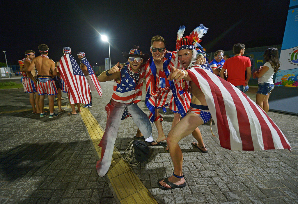 . US football fans celebrate after their team beat Ghana 2-1 in their first match of the 2014 FIFA football World Cup outside the Das Dunas Stadium, Natal on June 16, 2014. German-born United States defender John Brooks came off the bench to stun Ghana with a late winner in a 2-1 victory in Natal to put a huge dent in the 2010 World Cup quarter-finalists hopes of emulating that feat this time round. CARL DE SOUZA/AFP/Getty Images