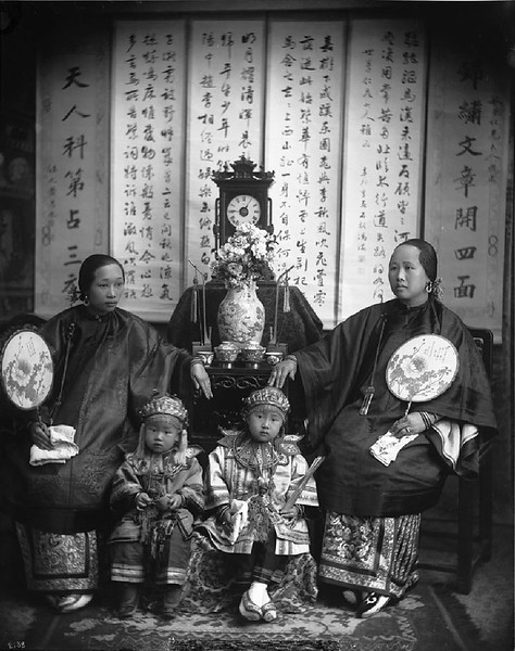 Chinese mother, daughter and children in fine costume