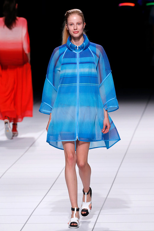 . A model presents a creation as part of Issey Miyake\'s ready-to-wear Spring/Summer 2014 fashion collection, presented Friday, Sept. 27, 2013 in Paris. (AP Photo/Jacques Brinon)