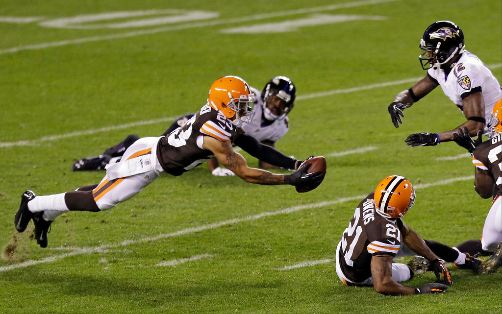 . Cleveland Browns cornerback Joe Haden, left, intercepts a pass against Baltimore Ravens wide receiver Jacoby Jones (12) in the second quarter of an NFL football game Sunday, Nov. 3, 2013, in Cleveland. (AP Photo/Tony Dejak)