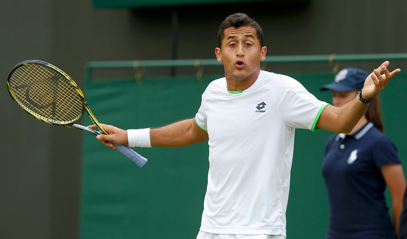 . Nicolas Almagro of Spain reacts to a line call in his men\'s singles tennis match against Guillaume Rufin of France at the Wimbledon Tennis Championships, in London June 26, 2013.      REUTERS/Eddie Keogh