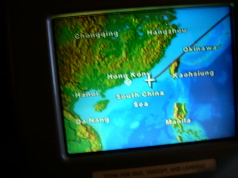 The map on my personal entertainment screen shows that we're closing in on Hong Kong.