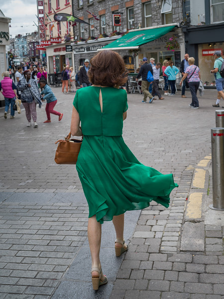 Rear view of Brunette in green dress on pedestrian walkway, Galway City, County Galway, Republic of Ireland