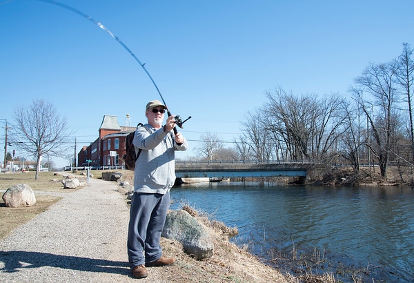 03/09/20 Wesley Bunnell | Staff Stan Hoge of Berlin with one of the his first casts of the season on a warm Monday afternoon March 9, 2020 at Papergoods Pond.
