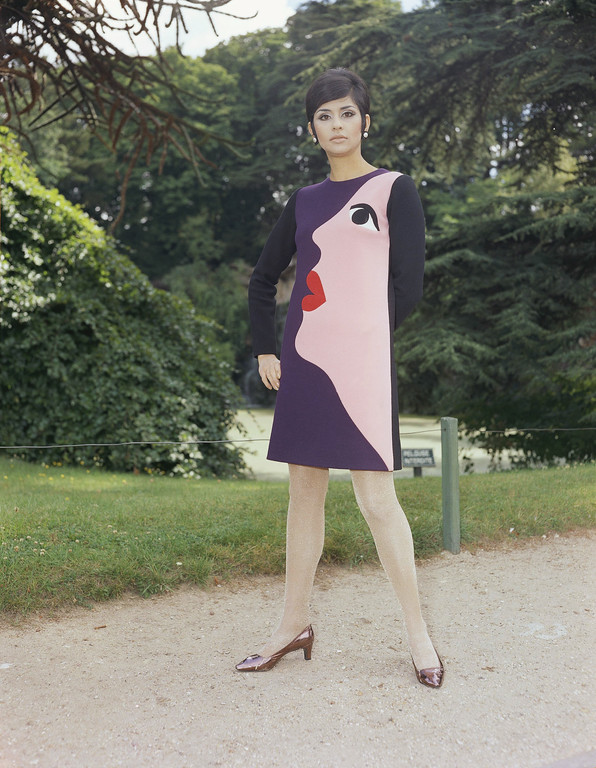 . Violet and black jersey dress with a feminine face profile on left side by Christian Dior in 1966. (AP Photo)