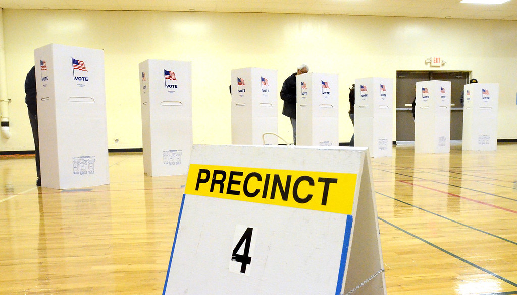 . Voting at Precinct 4 in the Waterford Parks and Recreation building.    Tuesday, November 4, 2014.  Tim Thompson-The Oakland Press