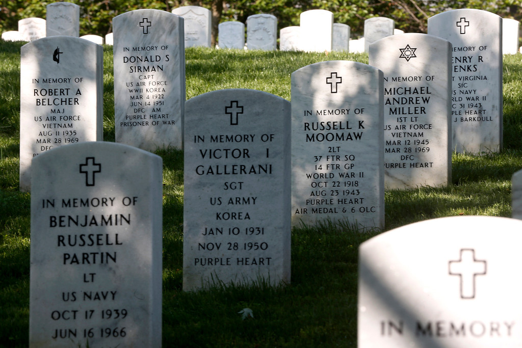 . Rows of gravestones lie near the gravesite of Army Pvt. William Christman, who was the first military burial at the cemetery, marking the beginning of commemorations of the 150th anniversary of Arlington National Cemetery in Arlington, Va., Tuesday, May 13, 2014. AP Photo)