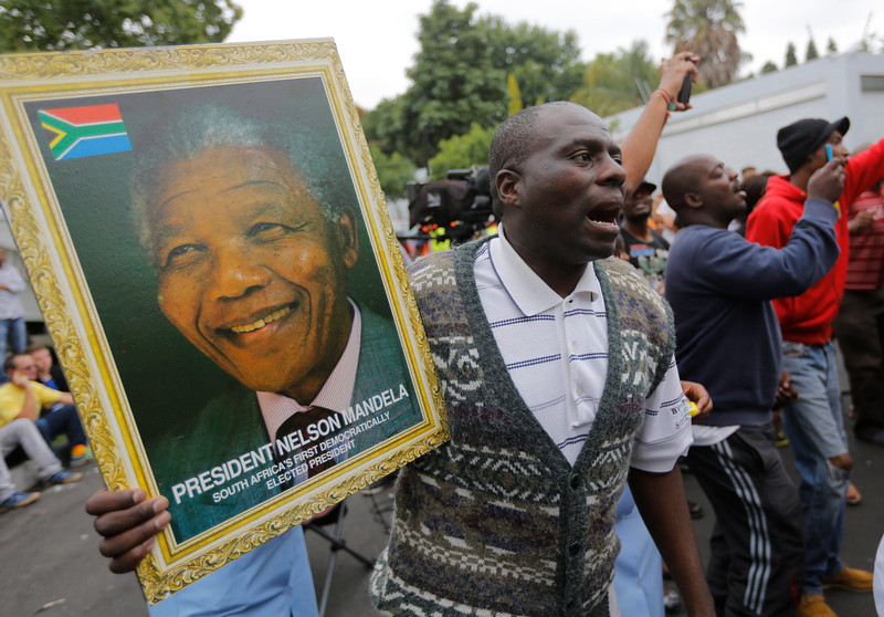 . Mourners gather and pray and sing outside the house of the late South African president Nelson Mandela in Johannesburg, South Africa, 06 December 2013. Nobel Peace Prize winner Nelson Mandela died at the age of 95, on 05 December 2013. A former lawyer, Mandela was the first black President of South Africa voted into power after the countries first free and fair democratic elections that witnessed  the end of the Apartheid system in 1994. Mandela was founding member of the ANC (African National Congress) and anti-apartheid activist who served 27 years in prison, spending many of these years on Robben Island. In South Africa, Mandela is often known as Tata Madiba, an honorary title adopted by elders of Mandela\'s clan. Mandela won the Nobel Peace Prize in 1993  EPA/KIM LUDBROOK