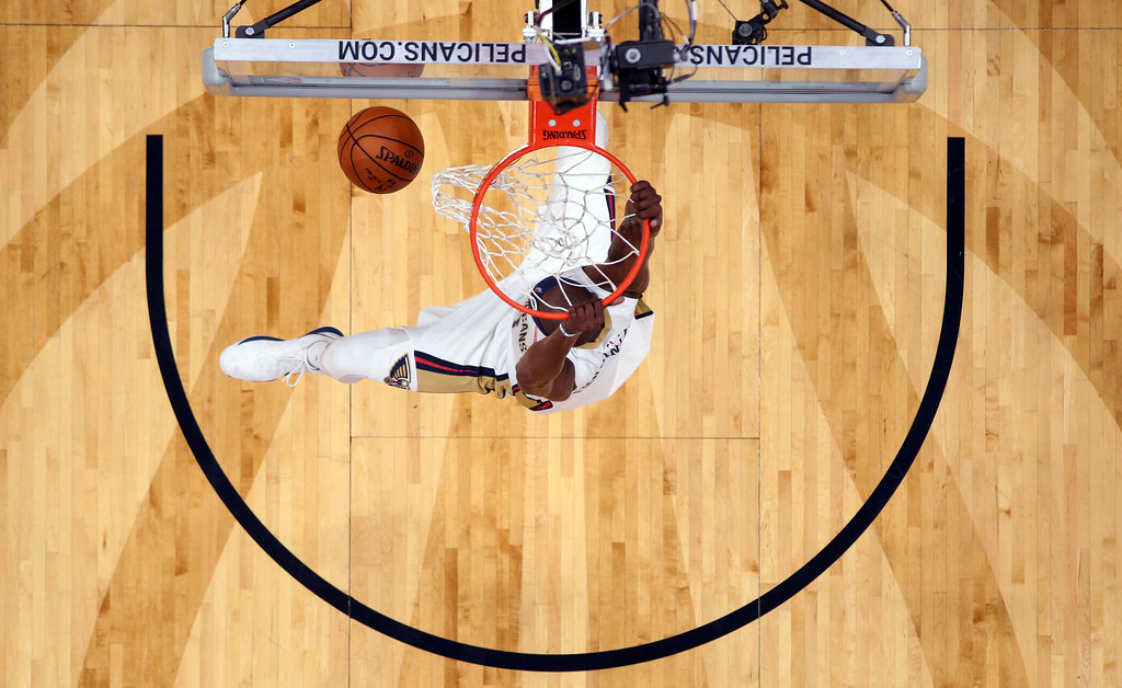 . New Orleans Pelicans forward Dante Cunningham slam dunks in the first half of an NBA basketball game against the Cleveland Cavaliers in New Orleans, Saturday, Oct. 28, 2017. (AP Photo/Gerald Herbert)