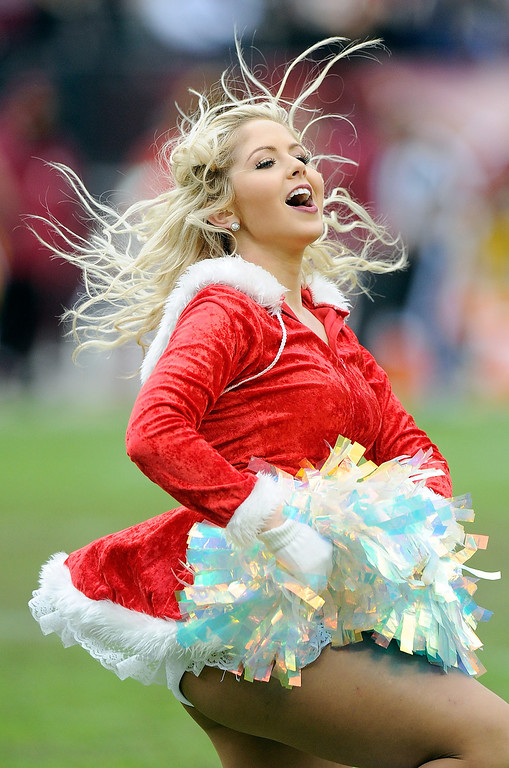 . A Redskins cheerleader performs during the game between the Washington Redskins and the Dallas Cowboys at FedExField on December 22, 2013 in Landover, Maryland.  (Photo by Greg Fiume/Getty Images)