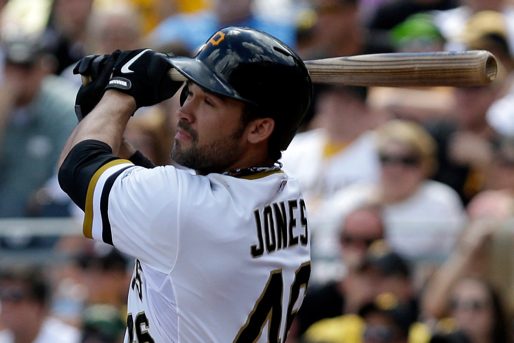 . Pittsburgh Pirates\' Garrett Jones (46) drives in a run with a single off Colorado Rockies starting pitcher Juan Nicasio (12) in the third inning of an MLB National league baseball game in Pittsburgh Sunday, Aug. 4, 2013. (AP Photo/Gene J. Puskar)