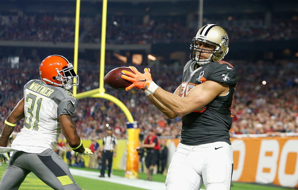 . GLENDALE, AZ - JANUARY 25: Team Irvin tight end Jimmy Graham #80 of the New Orleans Saints hauls in a pass over Team Carter safety Donte Whitner #31 of the Cleveland Browns during the first half of the 2015 Pro Bowl at University of Phoenix Stadium on January 25, 2015 in Glendale, Arizona.  (Photo by Christian Petersen/Getty Images)