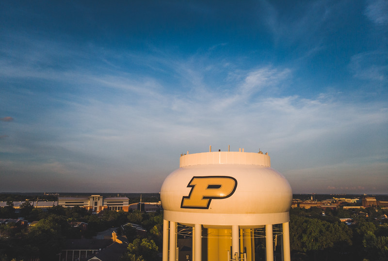 The sun sets in front of the Purdue water tower on the campus of Purdue University