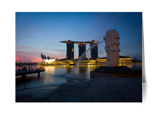 """Good Morning Singapore<br /> <br /> I can't count how many mornings I have woken up early in Singapore to capture a photograph of the sunrise.  I wanted the perfect blend of few clouds, a colorful sky, wet ground to give me the exact scene I wanted.  Finally after a lot of persistence I was able to get what I wanted.   As a photographer you need to be keep pushing to get what you want.  You can't settle.   It is a results orientated practice not an effort one.  <br /> <br /> The reward for my hard work:  I sold a print of this the day I took this photo!<br /> <br /> Read about the rest of this day on ShootTokyo:<br />  <a href=""""http://shoottokyo.com/working-a-shot/"""">http://shoottokyo.com/working-a-shot/</a>"""