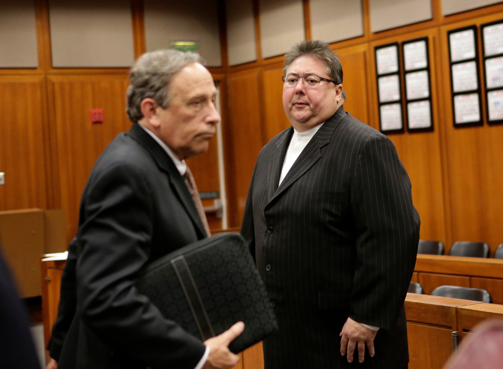 . George Shirakawa Jr., right, looks over at his attorney, John Williams, after entering a guilty plea at Santa Clara County Superior Court in San Jose, Calif. on Monday, March 18, 2013. Shirakawa pleaded guilty to five felonies, including four counts of perjury and one count of misappropriation of public funds, as well as seven misdemeanors for failing to file accurate campaign reports.  (Gary Reyes/ Staff)