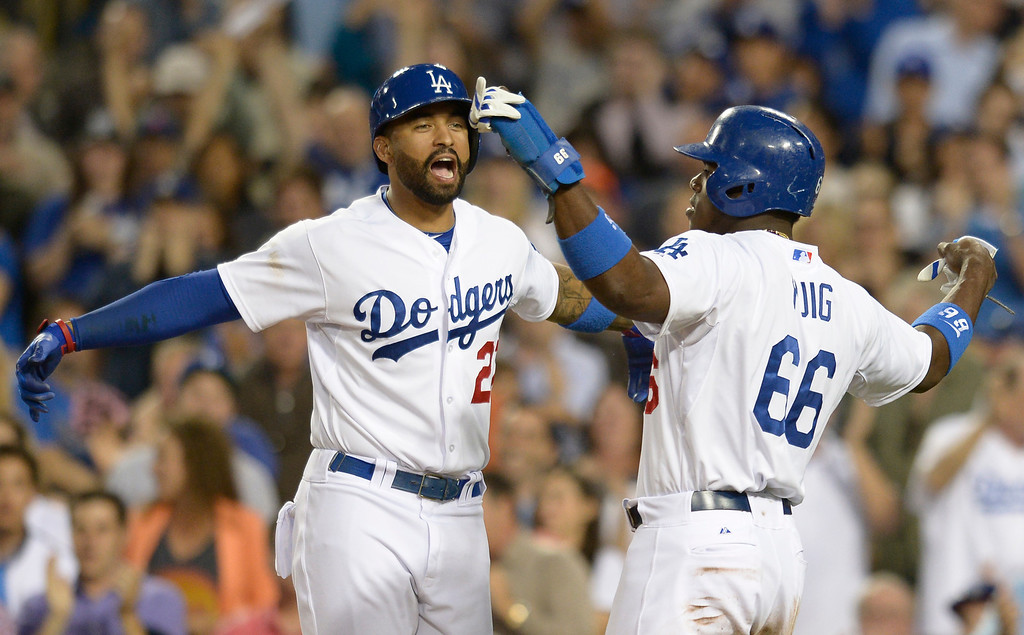. Dodgers Yasiel Puig is congratulated by Matt Kemp in the 3rd inning. Puig scored off an Adrian Gonzalez double. The Dodgers played the Colorado Rockies at Dodger Stadium in Los Angeles, CA. 6/18/2014(Photo by John McCoy Daily News)
