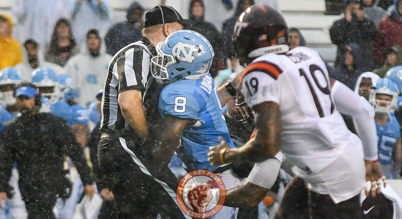 North Carolina running back T.J. Logan (8) runs into the referee on the Heels' first drive of the game. (Michael Shroyer/ TheKeyPlay.com)