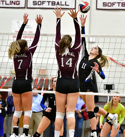 10/30/2019 Mike Orazzi | StaffrBristol Central Peyton Greger (7) and Kathryn Ross (14) and Bristol Eastern's Ryley Plourde (11) during Wednesday night's volleyball match at Bristol Central.