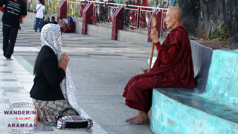 She asked the older monk to pray with/for her. He obliged.