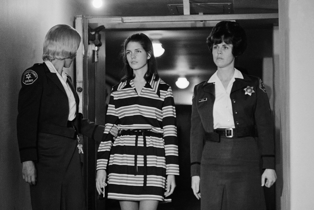 """. Leslie Van Houten, 19, a member of Charles Manson\'s \""""family\"""" who is charged with the murders of Leno and Rosemary LaBianca, is escorted by two deputy sheriffs as she leaves the courtroom in Los Angeles, Dec. 19, 1969 after a brief hearing at which time she was appointed a new attorney. The court appointed Marvin Part to represented Ms. Van Houten after her previous attorney said she and her family could not pay his fees. (AP Photo/George Brich)"""