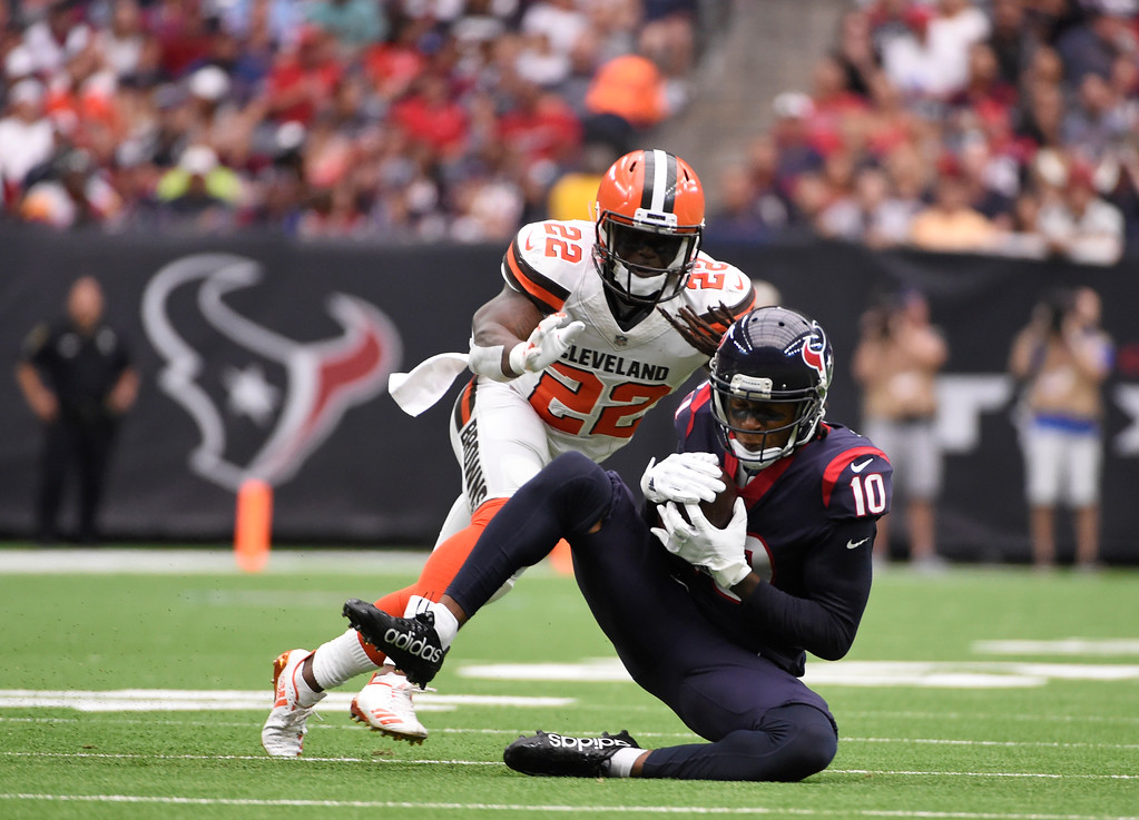 . Houston Texans wide receiver DeAndre Hopkins (10) catches in pass in front of Cleveland Browns safety Jabrill Peppers (22) in the first half of an NFL football game, Sunday, Oct. 15, 2017, in Houston. (AP Photo/Eric Christian Smith)